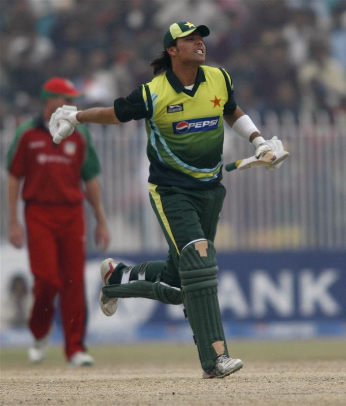 Khurram Manzoor reacts after scoring his maiden half century against Zimbabwe