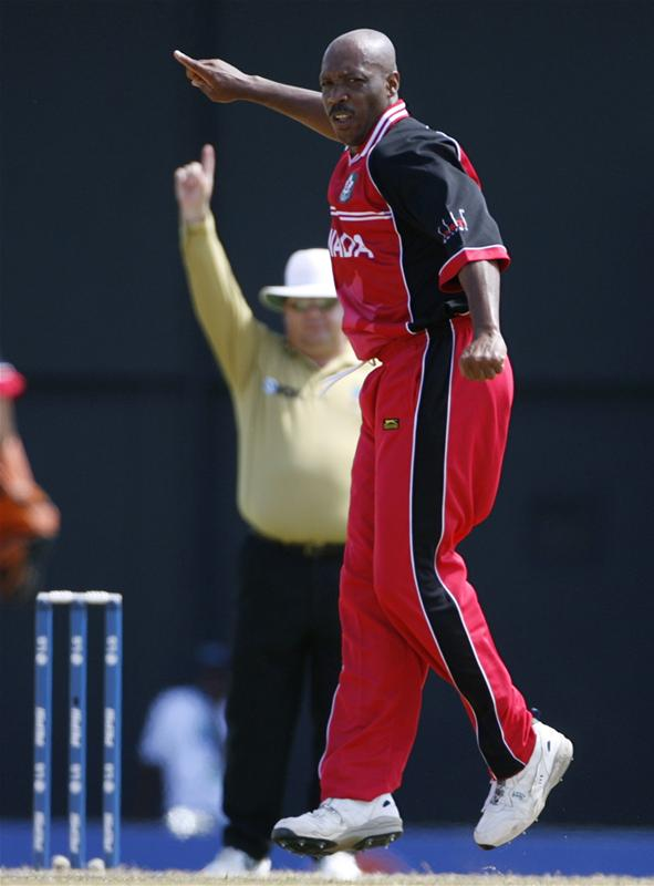 Anderson Cummins celebrates taking the wicket of David Obuya