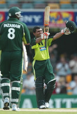 Pakistan wicketkeeper Kamran Akmal celebrates his maiden ODI century