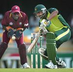 Inzaman-ul-Haq cuts a ball as West Indies' Courtney Browne