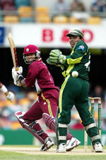 West Indies skipper Brian Lara cuts a ball past Kamran Akmal