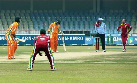 Shahnawaz Malik is about to face a ball from Mazhar Ali