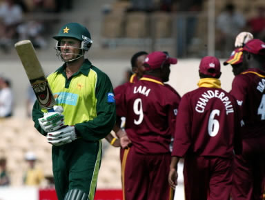 Abdul Razzaq walks after being caught