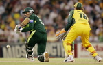 Abdul Razzaq sweeps while Adam Gilchrist looks on
