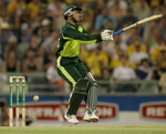 Abdul Razzaq tries to swing at a ball