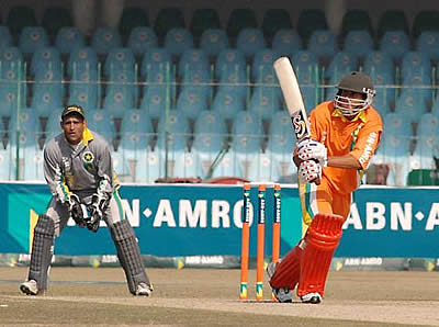 Lions batsman flicks one to Leg while Stallions Khalid Mahmood watches