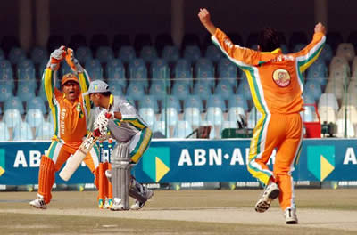 Lions keeper Humayun Farhat catches out Faisal Naved as Arsalan Mir celebrates