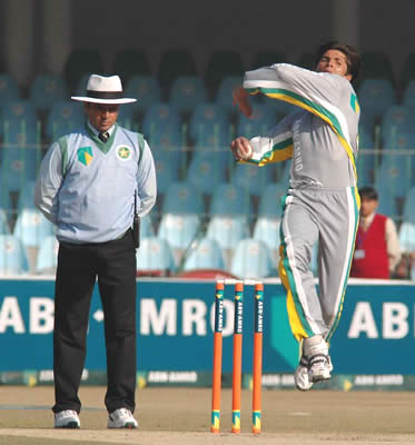 Stallions Mohammad Asif bowls as Aleem Dar supervises