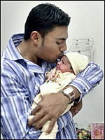 Danish Kaneria holds his daughter