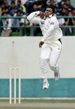 Danish Kaneria is airborne as he bowls