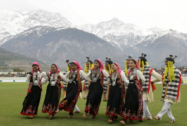 Indian folk dancers perform a routine