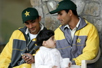 Abdul Razzaq's (R) daughter Ammna (C) plays in his lap
