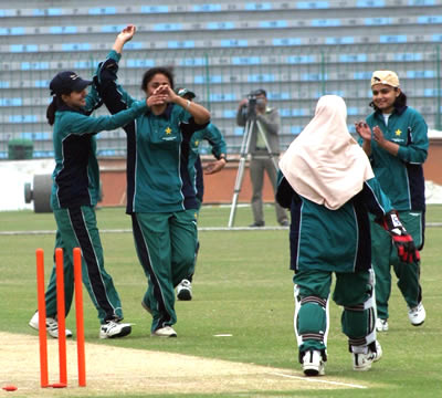 Shamsa Hashmi celebrates one of her 7 wickets with team members