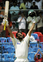 Inzamam-ul-Haq celebrates after reaching his century