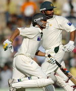 Younis Khan and Inzamam-ul-Haq take a run during their unfinished 316-run stand