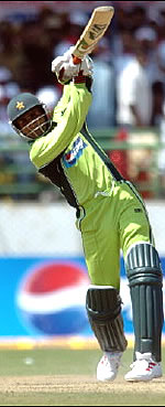Abdul Razzaq drives for a four