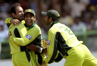 Naved-ul-Hasan, Yousuf Youhana and Kamran Akmal celebrate