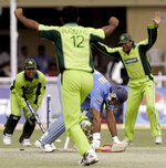 Abdul Razzaq is joined by his teammates
