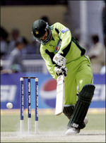 Shahid Afridi hits a ball to the boundary