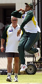 Danish Kaneria at practice watched by Bob Woolmer