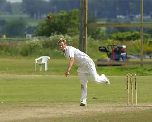 Ross Lyons bowling for Scotland