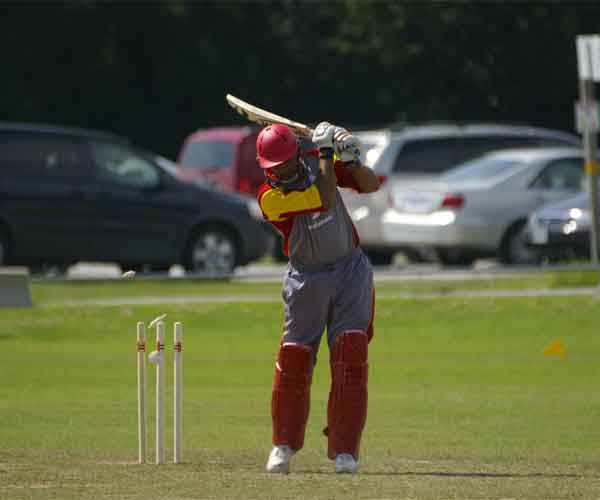 Photo of Rizwan Cheema of Canada being bowled by Steven Kelly