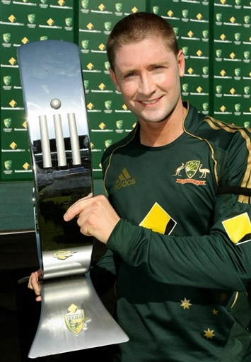 Michael Clarke poses with the trophy