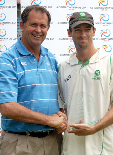 Dave Emslie, chief executive of Cricket Eastern Cape, presents Ireland's Alex Cusack with the man-of-the-match
