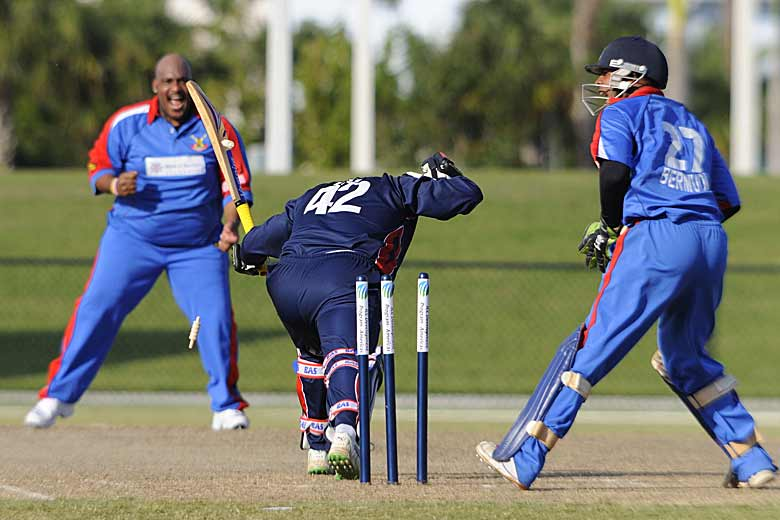 Cayman captain Pearson Best survives a stumping attempt by Bermudan wicket-keeper