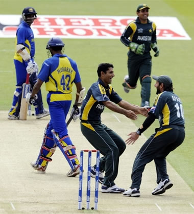 Razzaq celebrates the wicket of Mubarak