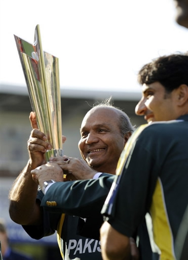 Pakistan's Coach Intikhab Alam holds the trophy