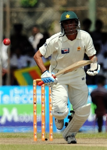 Younis plays a shot