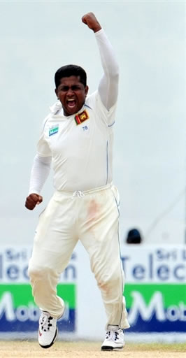 Herath celebrates after taking the wicket of Fawad