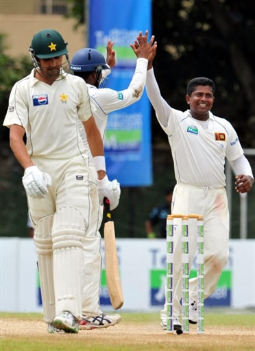 Herath celebrates the wicket of Umar Gul