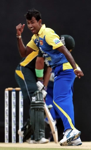 Kulasekara celebrates the wicket of Nasir Jamshed