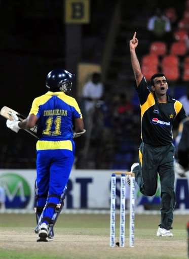 Iftikhar Anjum celebrates the wicket of Sangakkara