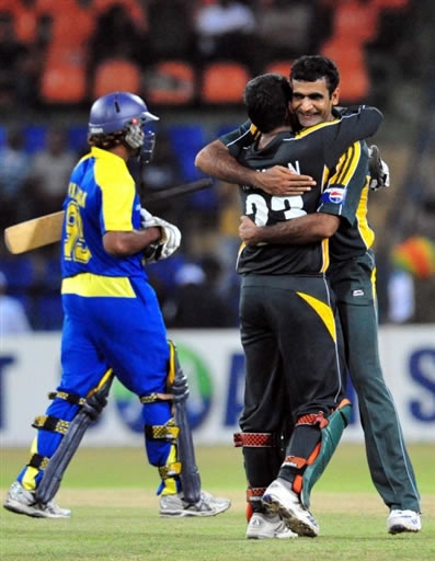 Iftikhar Anjum celebrates the wicket of Malinga