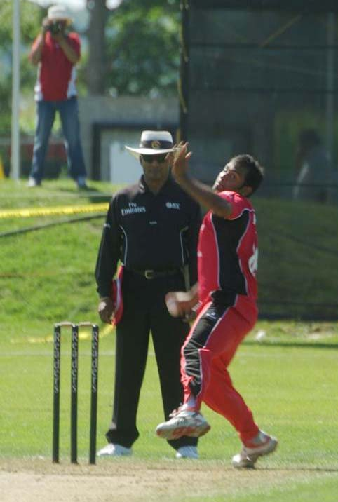 Khurram Chohan bowling during his fine spell of 4 for 26 from 10 overs