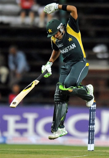 Umar Akmal reacts after ball hit him on the gloves
