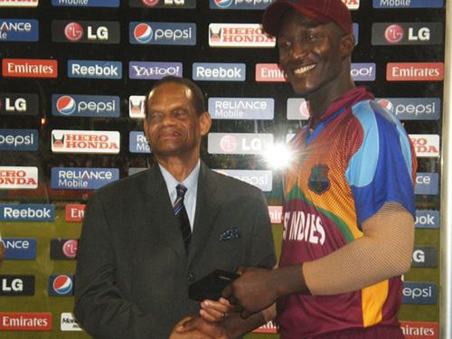 West Indies all-rounder Darren Sammy accepts his award