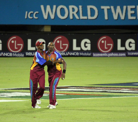 Chanderpaul and Bravo celebrate