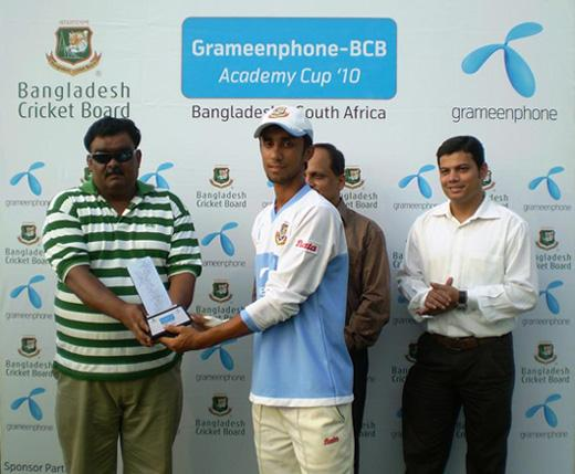 Shaker Ahmed receiving Man of the Match trophy