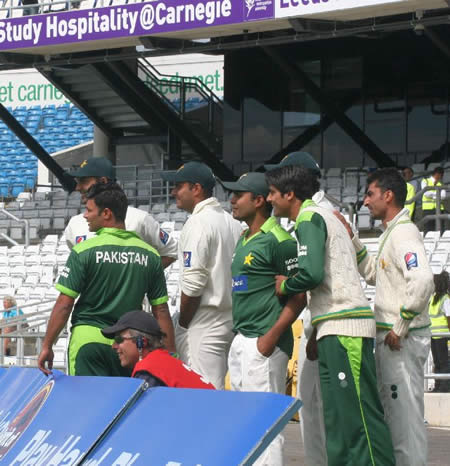 Pakistan players are ready to run in to celebrate their historic win