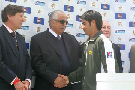 Salman Butt shakes hand with PCB Chairman during presentation