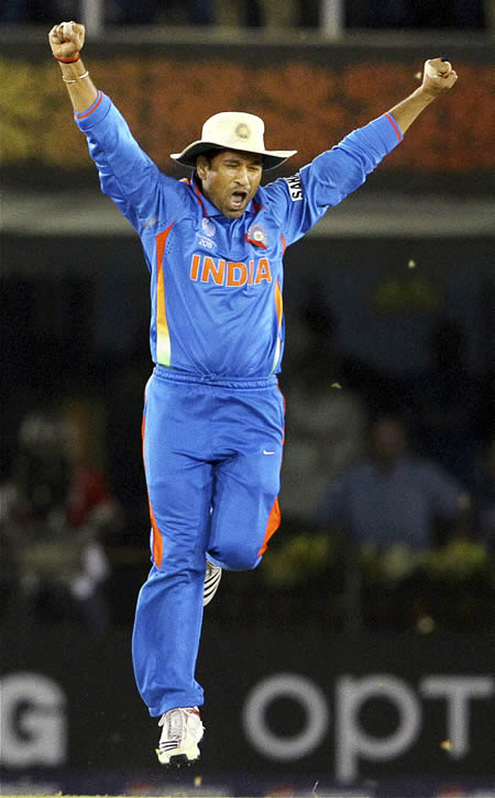 Sachin Tendulkar celebrates after victory in World Cup semi-final against Pakistan