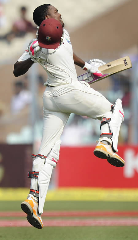Darren Bravo jumps in joy after reaching his century