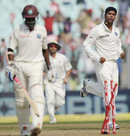 Shivnarine Chanderpaul walks back after having his stumps wrecked by Umesh Yadav
