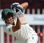 Younis Khan punches the ball down the ground