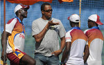 Courtney Walsh talks to members of the West Indian team at a training session