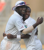 Darren Sammy and Fidel Edwards celebrate after a last-ball draw